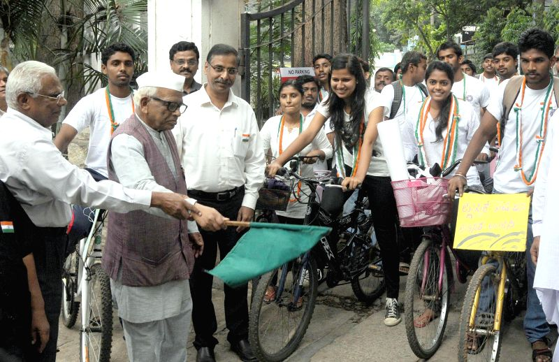 Karnataka Gandhi Smaraka Nidhi (KGSN) president Ho. Srinivasaiah flags-off a cycle rally organised to create awareness regarding ill effects of plastic in Bangalore on Aug 11, 2014. - Gandhi Smaraka Nidhi