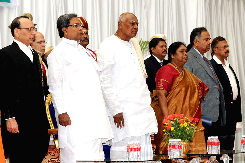 Karnataka Governor K Rosaiah with Chief Justice of Karnataka High Court D.H. Waghela, Karnataka Chief Minister Siddaramaiah and others during his swearing-in ceremony as the governor of the state at . - Siddaramaiah
