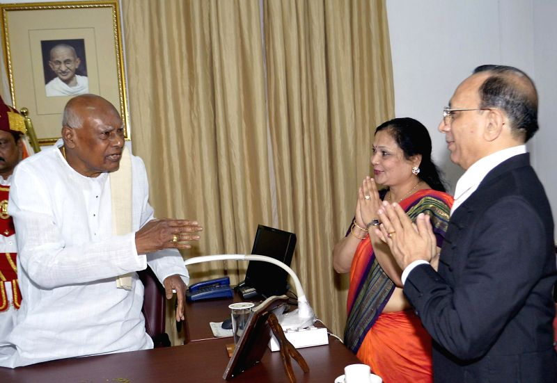 Karnataka Governor K Rosaiah with Chief Justice of Karnataka High Court D.H. Waghela after taking oath of office as the governor of the state at Raj Bhavan in Bangalore on June 29, 2014. Rosaiah is ..