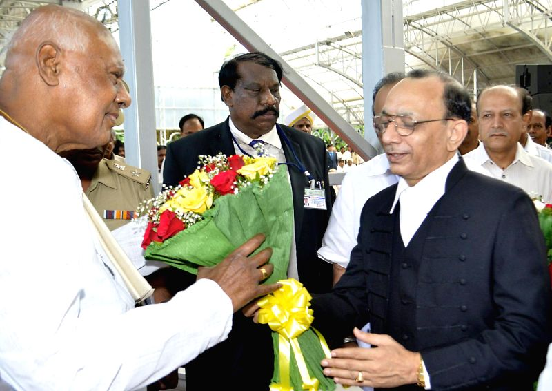 Karnataka Governor K Rosaiah with Chief Justice of Karnataka High Court D.H. Waghela after taking as the governor of the state at Raj Bhavan in Bangalore on June 29, 2014. Rosaiah is also the ...
