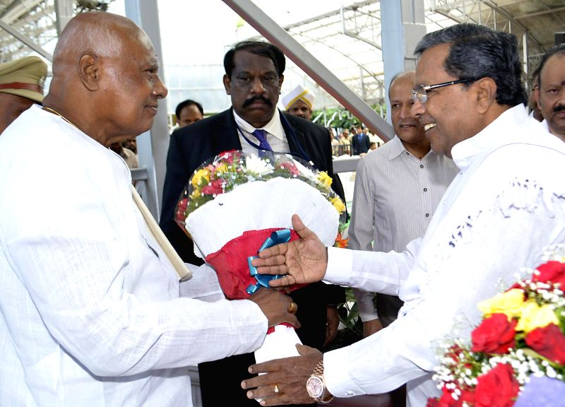 Karnataka Governor K Rosaiah with Karnataka Chief Minister Siddaramaiah after taking oath of office as the governor of the state at Raj Bhavan in Bangalore on June 29, 2014. Rosaiah is also the ... - Siddaramaiah