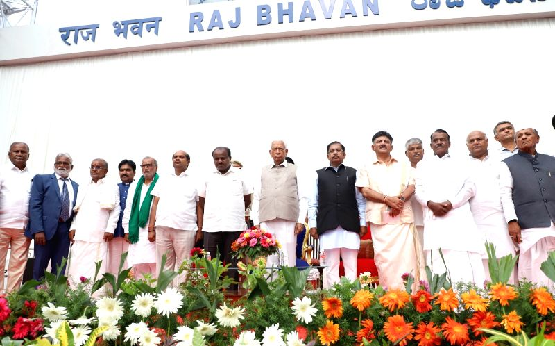 Karnataka Governor Vajubhai R. Vala, Chief Minister H.D. Kumaraswamy and Deputy Chief Minister G. Parameshwara during the swearing-in ceremony of 25 legislators who took oath as state ... - H., Shankar Reddy, Zameer Ahmed Khan, Shivanand Patil, Rajsekhar Basavaraj Patil and Puttaranga Shetty