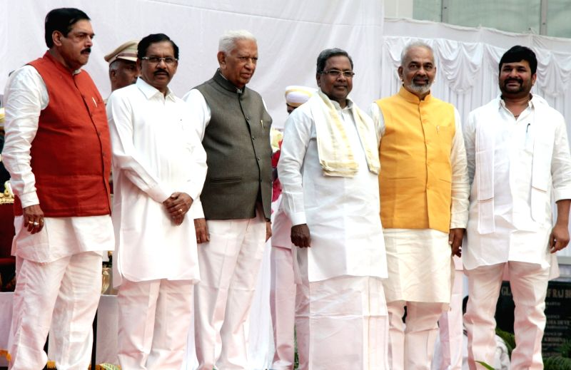 Karnataka Governor Vajubhai Rudabhai and Chief Minister Siddaramiah with the newly sworn in ministers Dr G Parameshwar, Manohar Tahasildar, A Manju and Vinay Kulkarni during the swearing ... - Siddaramiah and Vinay Kulkarni
