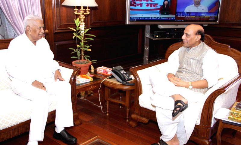 Karnataka Governor Vajubhai Rudabhai Vala calls on  Union Home Minister Rajnath Singh in New Delhi on September 04, 2014.