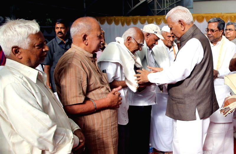 Karnataka Governor Vajubhai Rudabhai Vala greets freedom fighters during the tea party organised at Rajbhavan in Bengaluru on Aug 9, 2016.