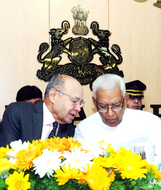 Karnataka Governor Vajubhai Vala with Dr. Justice Bhaskar Rao during a programme organised on `Lokayukta Day - 2015` at Lokayukta Office, in Bengaluru, on Jan 8, 2015. - Bhaskar Rao