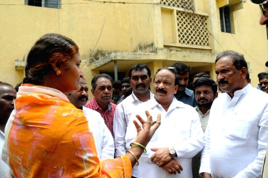 Karnataka Home Minister and Information Minister, K J George and Roshan Baig respectively, inspect the status of Police quarters in Bangalore on April 23, 2014.