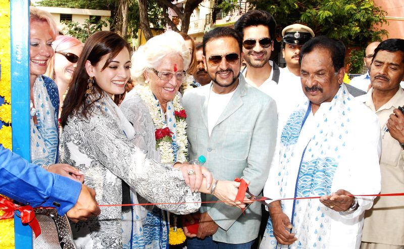 Karnataka Home Minister K J George and actors Gulshan Grover and Dia Mirza during inauguration of a water purification plant and launch of `The 8 Dreams project` on International Womens Day in ... - K J George, Gulshan Grover and Dia Mirza