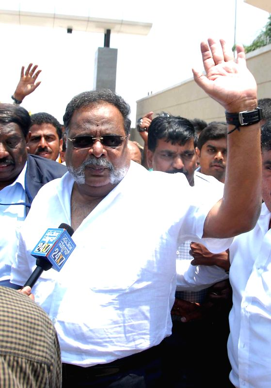 Karnataka Housing Minister Ambareesh returns back to Bangalore on April 11, 2014. He was undergoing treatment for a lung infection in a hospital of Singapore.