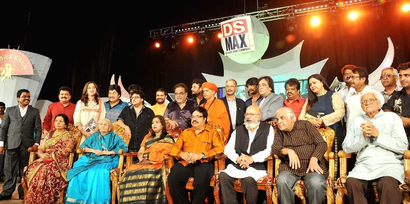 Karnataka Housing Minister and actor M.H. Ambarish and others during a programme in Bangalore on June 19, 2014.