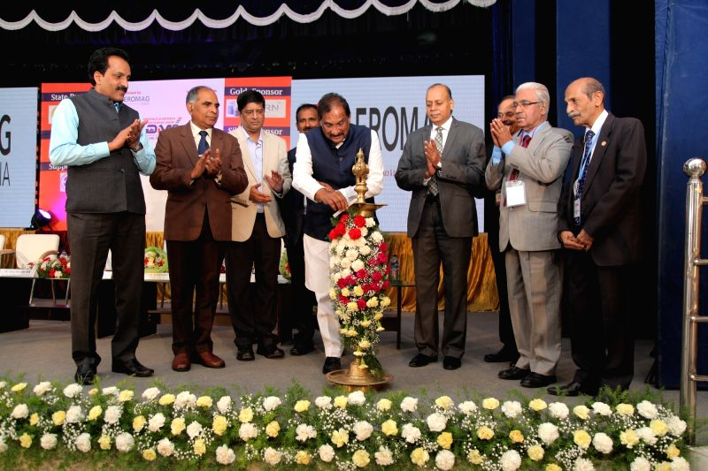 Karnataka Industries Minister K.J. George lighting the lamp to mark the inauguration of the two-day fifth Aerospace and Defence Manufacturing Show at the HAL Convention Centre in Bengaluru ... - K.