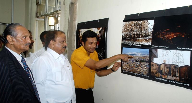 Karnataka Information Minister R Roshan Baig during Sudhir Shetty's photography exhibition on Rape and Prostitution in Bangalore on Aug 31, 2014. - R Roshan Baig