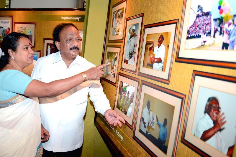 """Karnataka Information Minister Roshan Baig and Culture Minister Umashree at a photo exhibition of """"Bharata Ranta Prof. CNR Rao"""" organised by Information Dept. of Karnataka at Vidhana Soudha"""