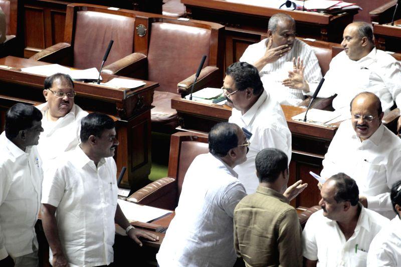 Karnataka legislators during monsoon session of Karnataka Legislative Assembly in Bangalore on June 27, 2014.