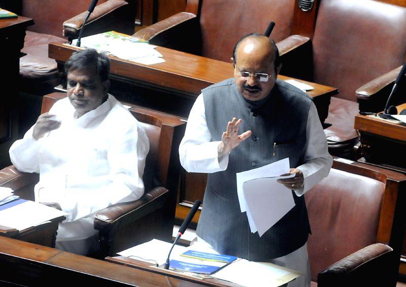 Karnataka legislators during the Monsoon Session of Karnataka Legislative Assembly in Bangalore on June 30, 2014.