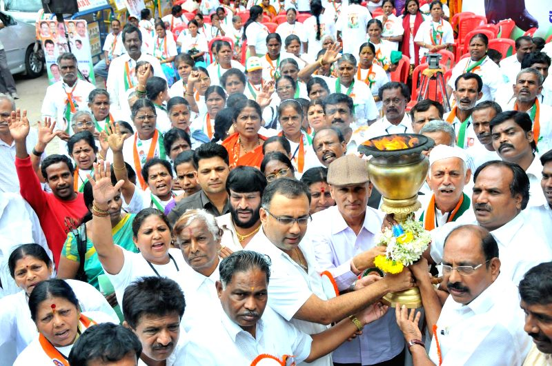 Karnataka Minister Dinesh Gundu Rao during inauguration of Rajiv Gandhi Jyothi yatra in Bangalore on Aug 10, 2014. - Dinesh Gundu Rao