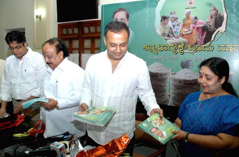 Karnataka Minister for Food and Civil Supplies Dinesh Gundu Rao and Karnataka Infrastructure Development Minister R Roshan Baig release the first anniversary report of Anna Bhagya Scheme at Vidhana .. - R Roshan Baig