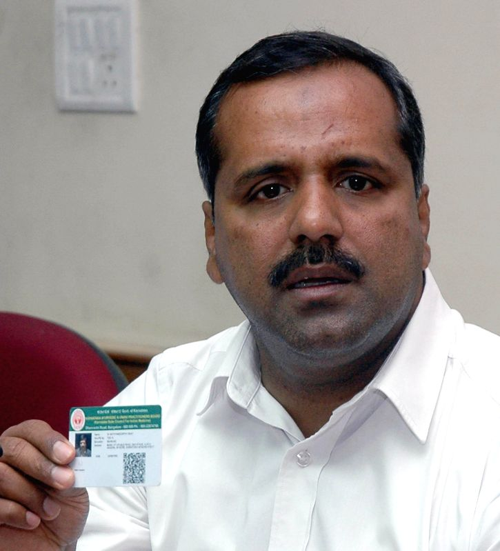 Karnataka Minister for Health and Family Welfare UT Khader briefs media regarding Bio Metric Cards for  Ayurvedic and Unani practitioners in Bangalore on August 1, 2014.