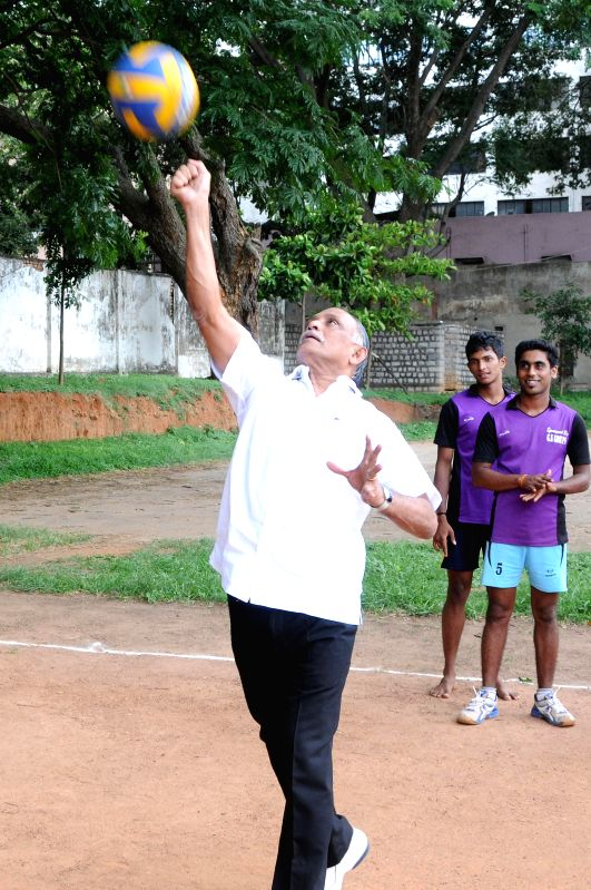 Karnataka Minister for Youth Services K Abhay Chandra Jain plays volleyball during inauguration of 'Koti Chennaya Kreeda Koota - 2014'  (Koti Chennaya Sports Meet) organised by Billava Association at