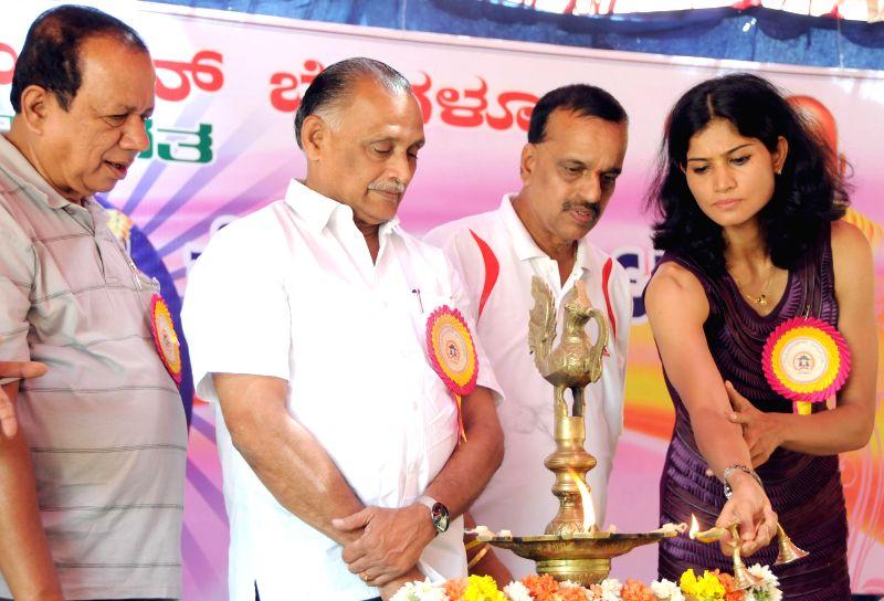 Karnataka Minister for Youth Services K Abhay Chandra Jain and athlete Sahana Kumari during inauguration of 'Koti Chennaya Kreeda Koota - 2014'  (Koti Chennaya Sports Meet) organised by Billava ...