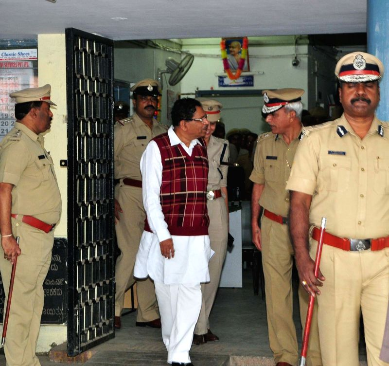 Karnataka Minister G Parameshwara during his surprise visit to Madiwala Police Station in Bengaluru, on Dec 1, 2015. - G Parameshwara