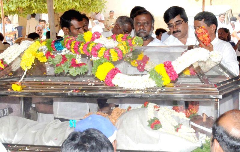Karnataka Social Welfare Minister H Anjenaiah pays his last respect to Karnataka JD(S) president and party candidate for Tumkur Lok Sabha seat, A Krishnappa who passed way following a heart-attack at - H Anjenaiah