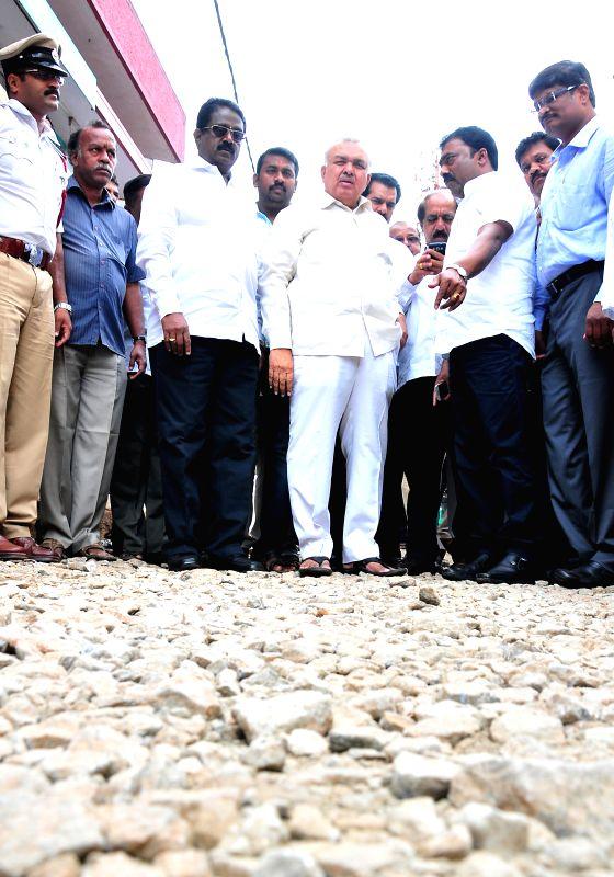 Karnataka Transport Minister Ramalinga Reddy, Bangalore Mayor B S Satyanarayana and others inspect Peenya industrial area in Bangalore on Aug 5, 2014. - Ramalinga Reddy