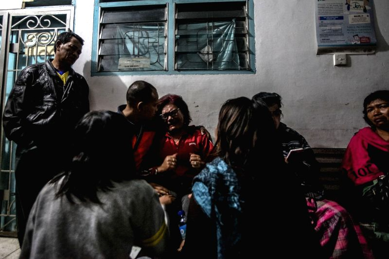 KARO, May 22, 2016 - Family members of Sinabung volcano eruption victims mourn their deaths in Karo, North Sumatra, Indonesia, on May 22, 2016. Three people were killed and four other were seriously ...