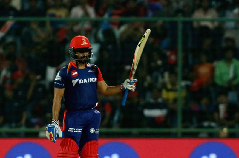 Karun Nair of the Delhi Daredevils raises his bat after reaching his fifty during match between the Delhi Daredevils and the Rising Pune Supergiant held at the Feroz Shah Kotla Stadium in ...