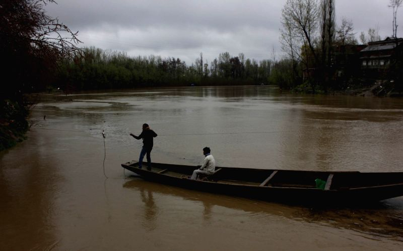 A view of swollen Jhelum river after heavy rainfalls in Kashmir valley on March 29, 2015.