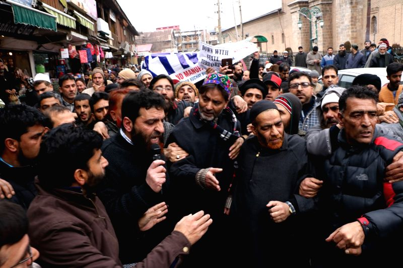 Kashmir Liberation Front (JKLF) chief Yasin Malik along with the Joint Resistance ership (JRL) and Downtown Traders participate in a joint protest against the killing of civilians in ... - Malik