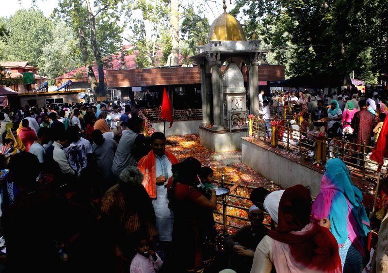 Kashmiri Pundits offer prayers at Kheer Bhawani Temple located near Tula Mula village around 22 km east of Srinagar on June 6, 2014.
