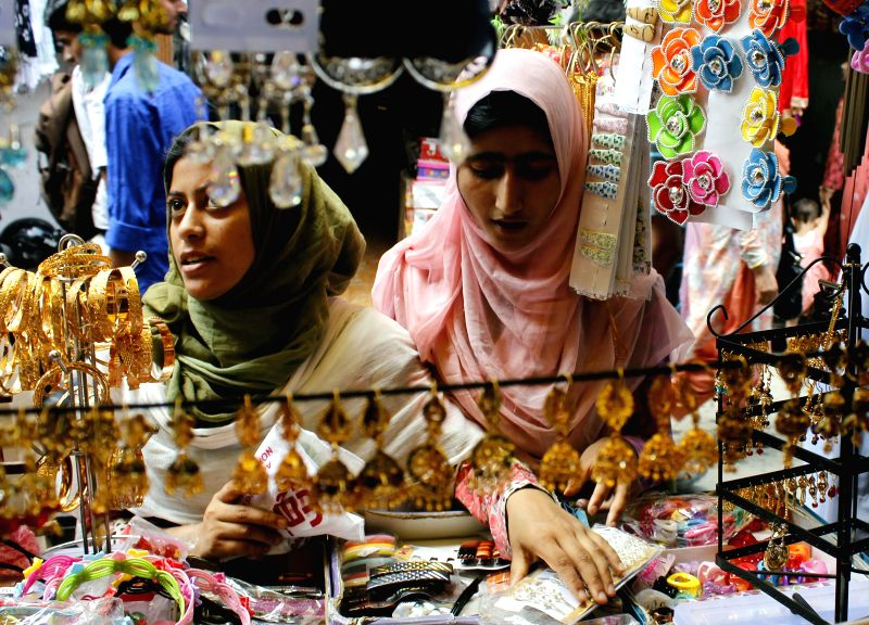 Kashmiri women busy shopping ahead of Eid ul-Fitr in Srinagar on July 27, 2014.