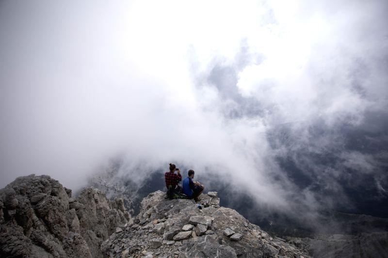"KATERINI (GREECE), Aug. 9, 2018 Photo taken on Aug. 8, 2018 shows mountaineers enjoying the view from ""Mytikas"", the highest peak of Mount Olympus, northern Greece. Mount ..."
