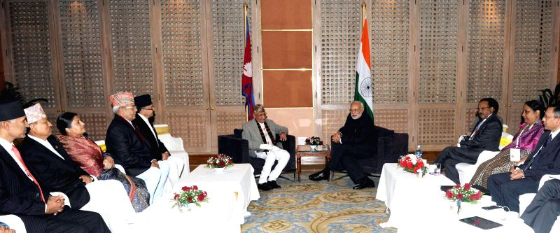 A delegation of CPN-UML leaders calls on Prime Minister Narendra Modi, in Kathmandu, Nepal, on Nov 25, 2014. - Narendra Modi