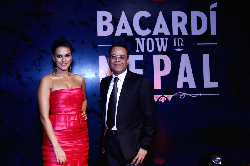 Actress Neha Dhupia with BACARDI India Director (Sales and Marketing) Manish Seth at the launch of a liquor brand in Kathmandu, Nepal on Jan 5, 2015. - Manish Seth