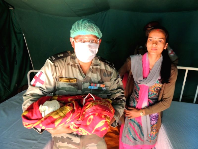 An army official with the baby girl `Bharti` who was born at an Indian Army run field hospital in Kathmandu on May 15, 2015.
