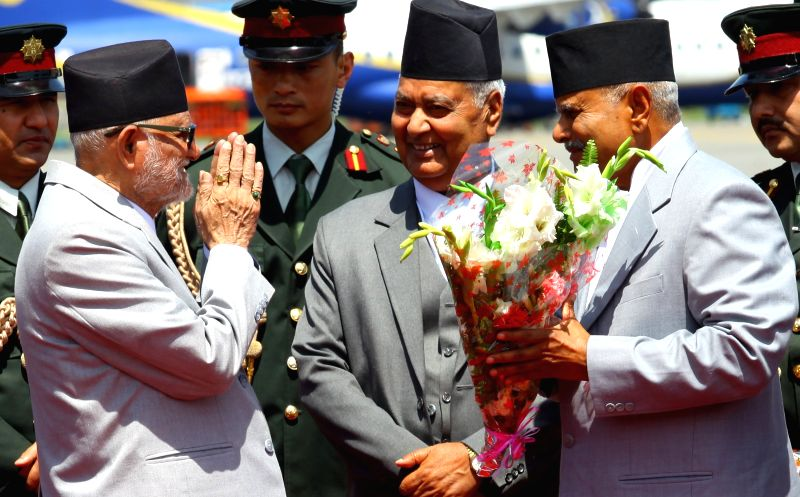 Nepalese President Ram Baran Yadav (R) receives a bunch of flowers from Nepalese Prime minister Sushil Koirala after arriving from China's official visit at ... - Sushil Koirala and Baran Yadav