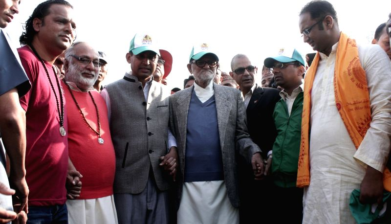 Prime Minister of Nepal Sushil Koirala (C) participates in a human chain to mark the 100th week of the Bagmati Clean-up Campaign in Kathmandu, Nepal, April 11, ...