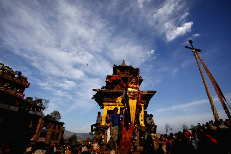Nepalese devotees get ready to pull the chariot of God Bhairab through the city centre during the last day of Bisket Jatra festival in Bhaktapur, Nepal, April ...