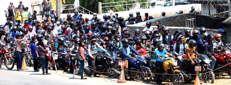 Nepalese bikers are seen waiting in a queue for petrol at Bhadrakali fuel station in Kathmandu, Nepal, April 16, 2014. Petroleum products are once again in ...
