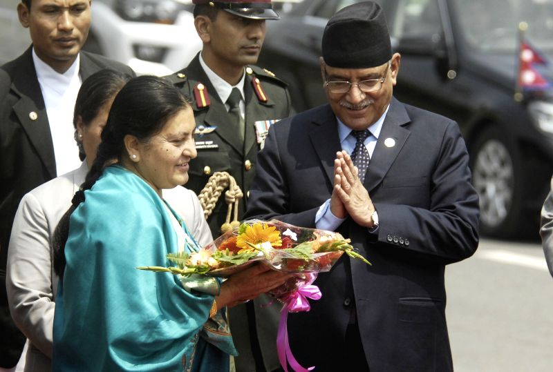 KATHMANDU, April 17, 2017 - Nepali President Bidya Devi Bhandari (L, front) is greeted by Prime Minister Pushpa Kamal Dahal (1st R) before she leaves for India on a five-day visit in Kathmandu, ... - Pushpa Kamal Dahal