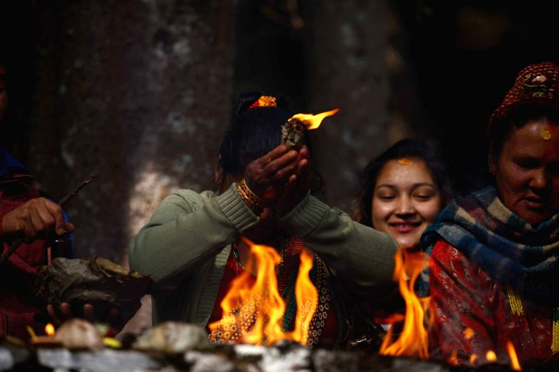 A devotee offers prayers on Mother's Day, or Mata Tirtha Aunsi, at Matatirtha in Kathmandu, Nepal, April 18, 2015. Nepalese observe this day as showing their ...