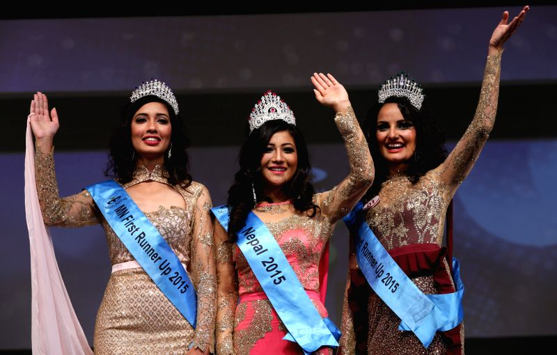 Winner of Miss Nepal 2015 Evana Manandhar (C), first runner-up Dibyata Vaidya (L) and second runner-up Medha Koirala wave to the audience in the grand finale ...