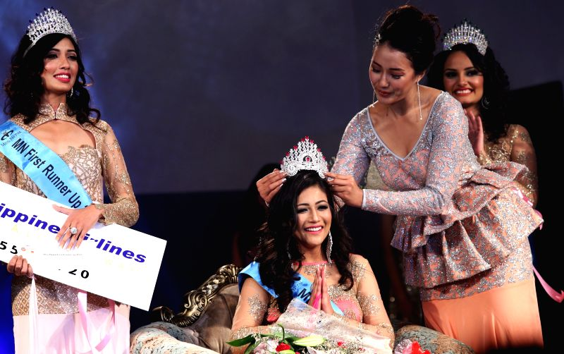 Winner of Miss Nepal 2015 Evana Manandhar (C) is crowned by Miss Nepal 2014 Subin Limbu in the grand finale Miss Nepal 2015 beauty pageant in Kathmandu, Nepal, ...