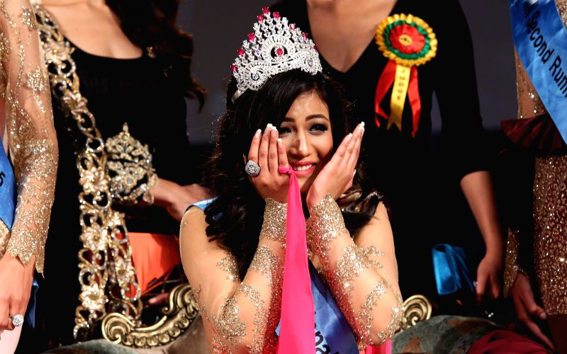 Winner of Miss Nepal 2015 Evana Manandhar reacts after being crowned the title in the grand finale Miss Nepal 2015 beauty pageant in Kathmandu, Nepal, April 18, ...