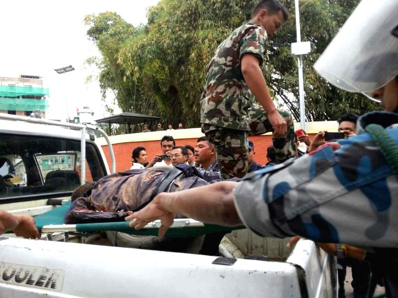 People put a victim's body on a vehicle in Nepal's capital Kathmandu April 25, 2015. An 8.1-magnitude earthquake struck Nepal, at 2:11 p.m. (Beijing Time) (0622 ...