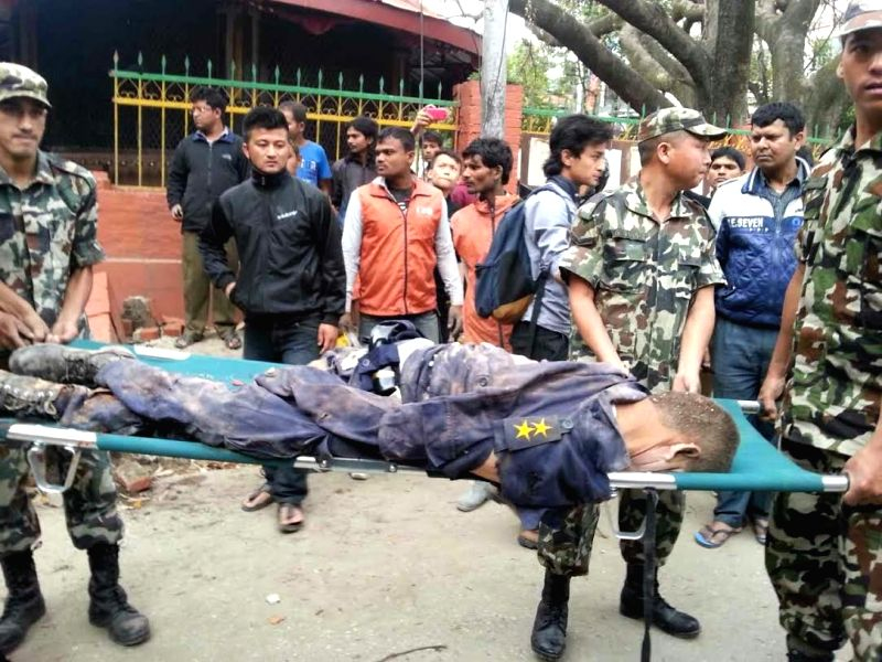 Rescuers transfer a body from a site struck by an earthquake in Kathmandu, Nepal, on April 25, 2015. An 8.1-magnitude earthquake struck Nepal, at 2:11 p.m. ...