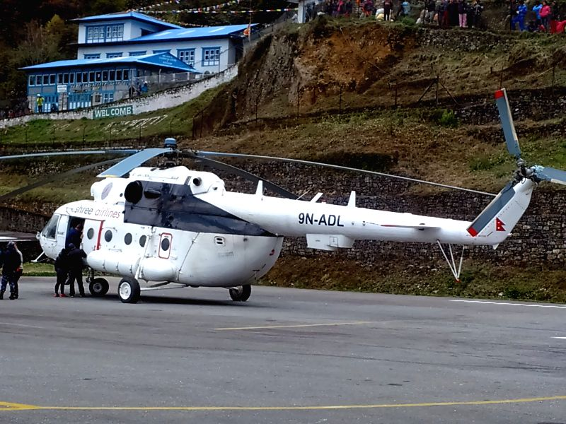 A helicopter carrying climbers is seen at the aiport in Lukla, Nepal, April 26, 2015. At least 18 mountaineers have been confirmed killed in the avalanche in ...