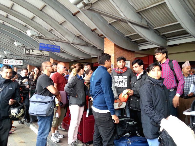 Passengers wait to leave at Tribhuwan International Airport in Kathmandu, Nepal, April 26, 2015. Death toll from Nepal earthquake surpasses 1,800, and over 4,700 ...